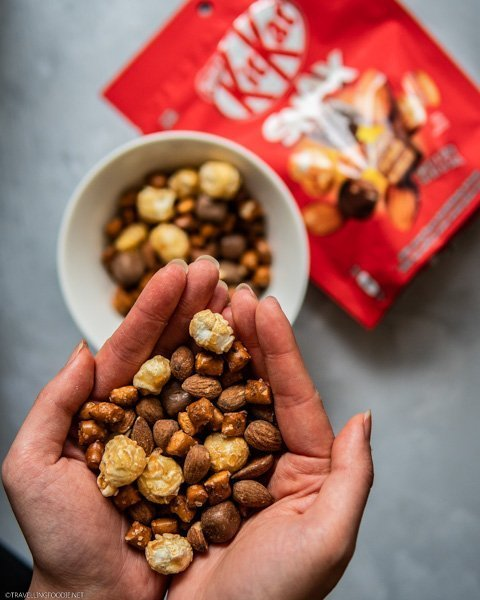 Enjoying handfuls of KITKAT Snax with KITKAT, caramel popcorn, roasted almonds and pretzels