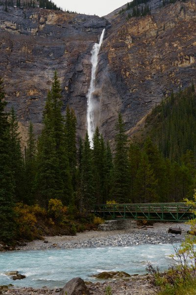 Takakkaw Falls with bridge and river at Yoho National Park, British Columbia in the Canadian Rockies