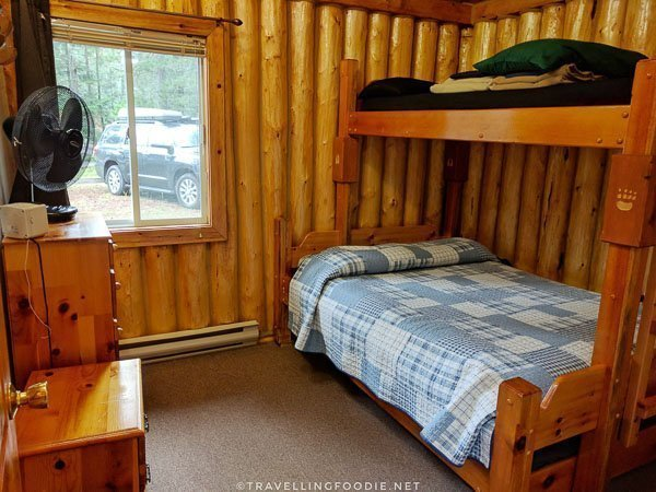 Cottage Log Suite bedroom at Ivanhoe River Inn in Sudbury, Ontario