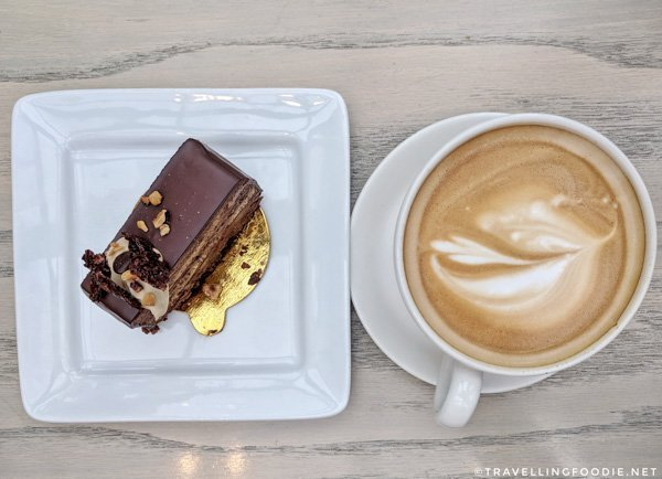 Mocha Hazelnut Cake and Cappuccino at Alforno Cafe and Bakery in Calgary, Alberta