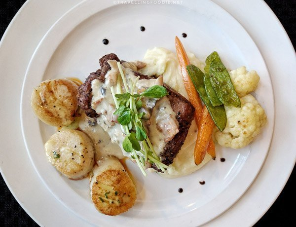 Grilled Elk Striploin with seared scallops at Cedar Meadows in Timmins, Ontario