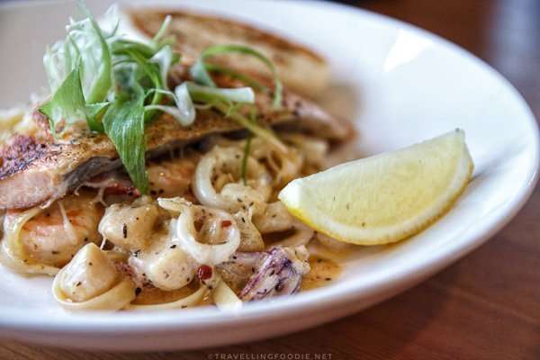 Cajun Seafood Fettuccine with Salmon at Maple Avenue Tap and Grill in Haliburton, Ontario
