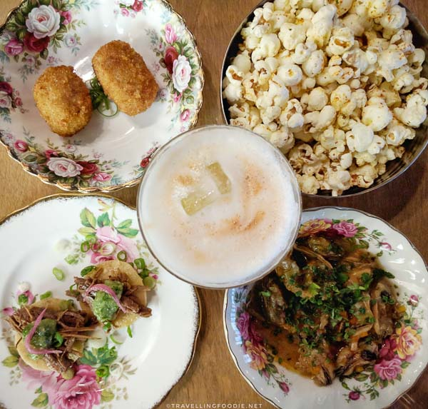 Popcorn, olives, mussels, beef tostada, whiskey sour at 11th Mile Restaurant in Fredericton, New Brunswick