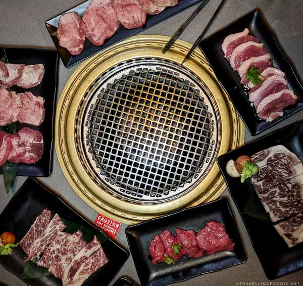 Yakiniku dishes beside the grill at Gyu-Kaku Japanese BBQ in Torrance, California