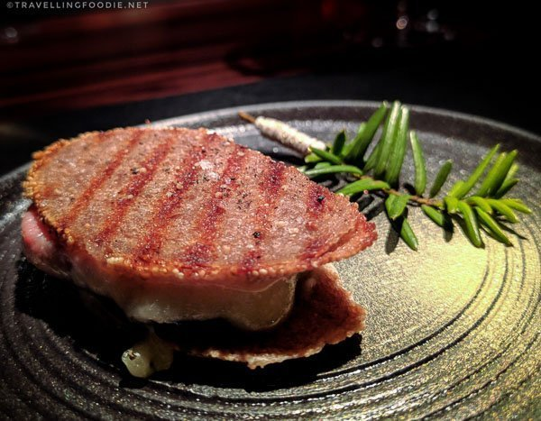Black truffle wafer with ham and cheese at L'Atelier de Joël Robuchon Montreal