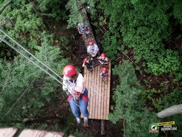 View from the platform of someone rappelling at Long Point Eco Adventures in St. Williams, Norfolk County, Ontario