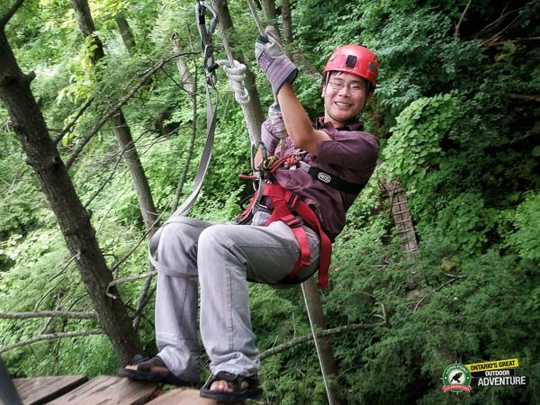 Travelling Foodie Raymond Cua rappelling at Long Point Eco Adventures in St. Williams, Norfolk County, Ontario