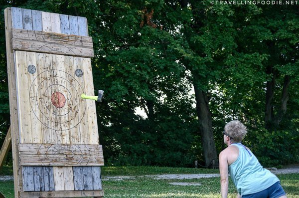 Lady axe throwing at Long Point Eco Adventures in St. Williams, Norfolk County, Ontario