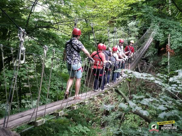 People walking on suspension skybridge at Long Point Eco Adventures in St. Williams, Norfolk County, Ontario
