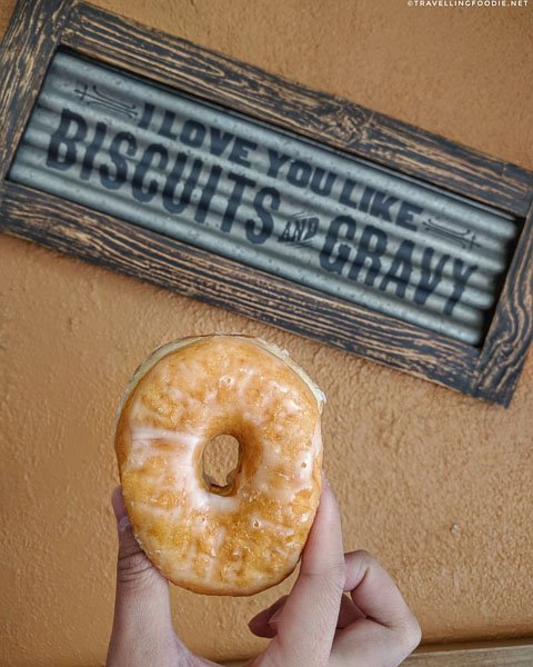 Donut with I Love You Like Biscuits and Gravy Sign at Mr. Bill's Donuts in DeLand, West Volusia, Florida