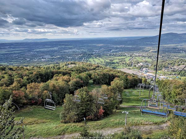 Chair lift going down at Ski Bromont in Bromont, Quebec