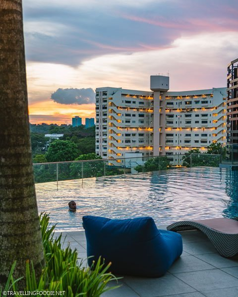 Sunset Infinity Pool with Chairs at Park Hotel Alexandra in Singapore