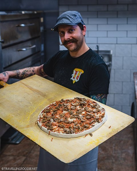 Pizza Chef Dean Litster making pizza at Armando's Pizza in Windsor, Ontario