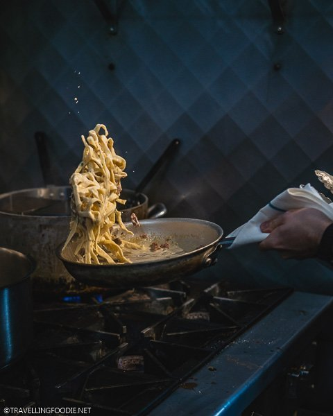 Cooking Fettuccini Alfredo at Fat Olive Restaurant in Dorchester, Ontario