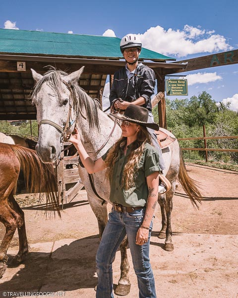 Travelling Foodie Raymond Cua riding hose at Academy Riding Stables in Colorado Springs