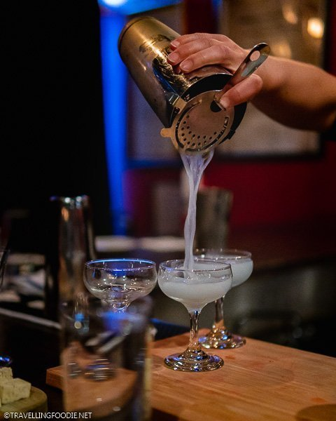 Pouring Aviation Cocktail High for Rocky Mountain Food Tours in Colorado Springs