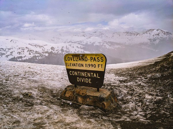 Loveland Pass Continental Divide Sign saying Elevation 11,990 feet in Colorado