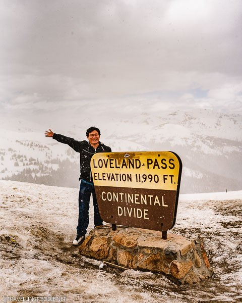 Travelling Foodie Raymond Cua at Loveland Pass Continental Divide Sign in Colorado