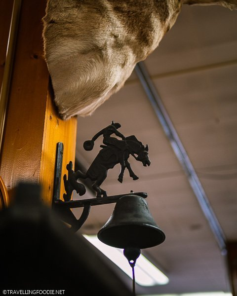 Cowboy Riding a Horse Bell at FM Light and Sons in Steamboat Springs