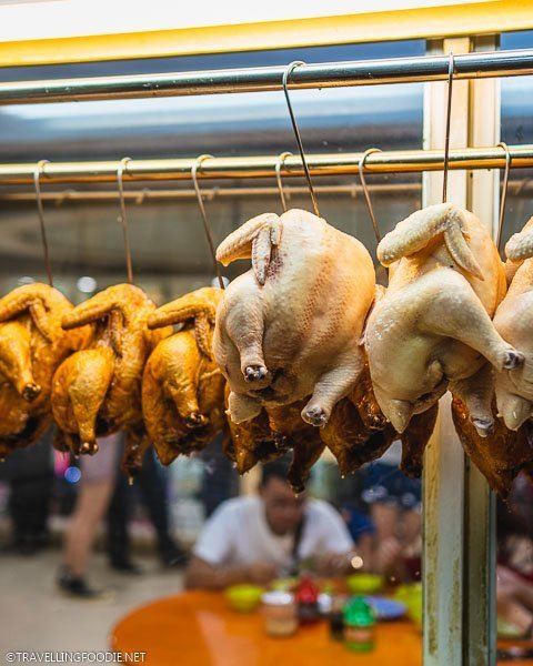 Soy Sauce Chicken and Hainanese Chicken on display at Hainanese Delicacy in Singapore