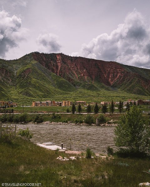 River, Colorful Buildings and Mountain Views at Iron Mountain Hot Springs