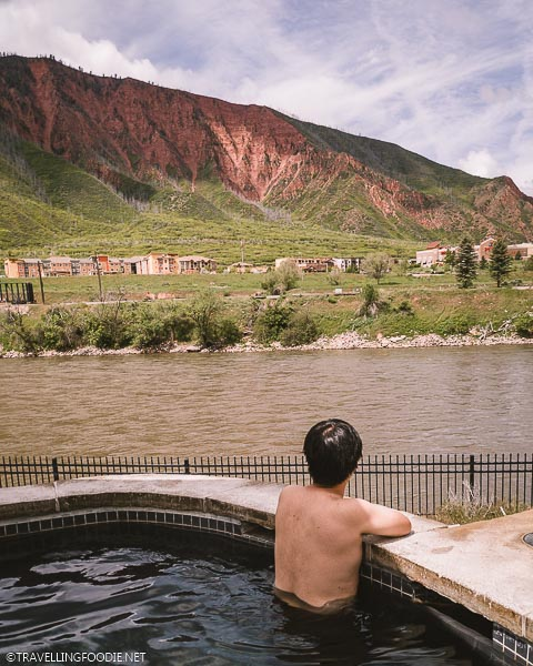 Travelling Foodie Raymond Cua looking away in hot springs at Iron Mountain Hot Springs