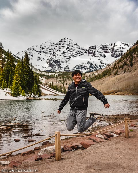 Travelling Foodie Raymond Cua jumping at Maroon Bells in Aspen