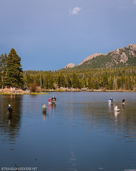 People fly fishing at Sprague Lake in Rocky Mountain National Park Colorado