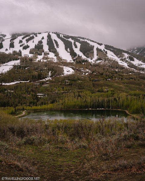 Ziegler Reservoir with Snow Mountains in Snowmass, Colorado