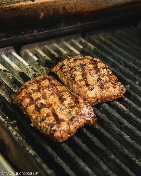 Two Certified Angus Steaks on Grill