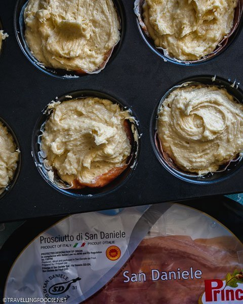 Prosciutto and Cheese Cupcakes on Cupcake Tray with a pack of Prosciutto di San Daniele