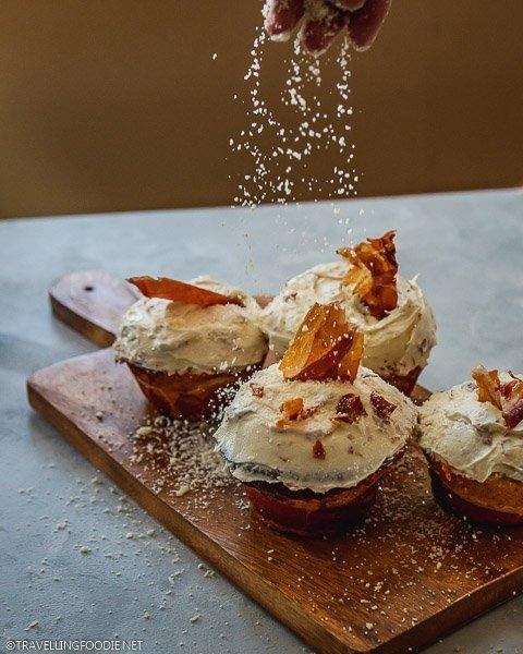 Sprinkling Grana Padano Cheese on Cheesecakes on Blanket