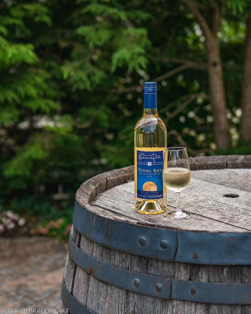 Tidal Bay Wine on top of Wine Barrel at Domaine Grand Pre Vineyards in Wolfville, Nova Scotia