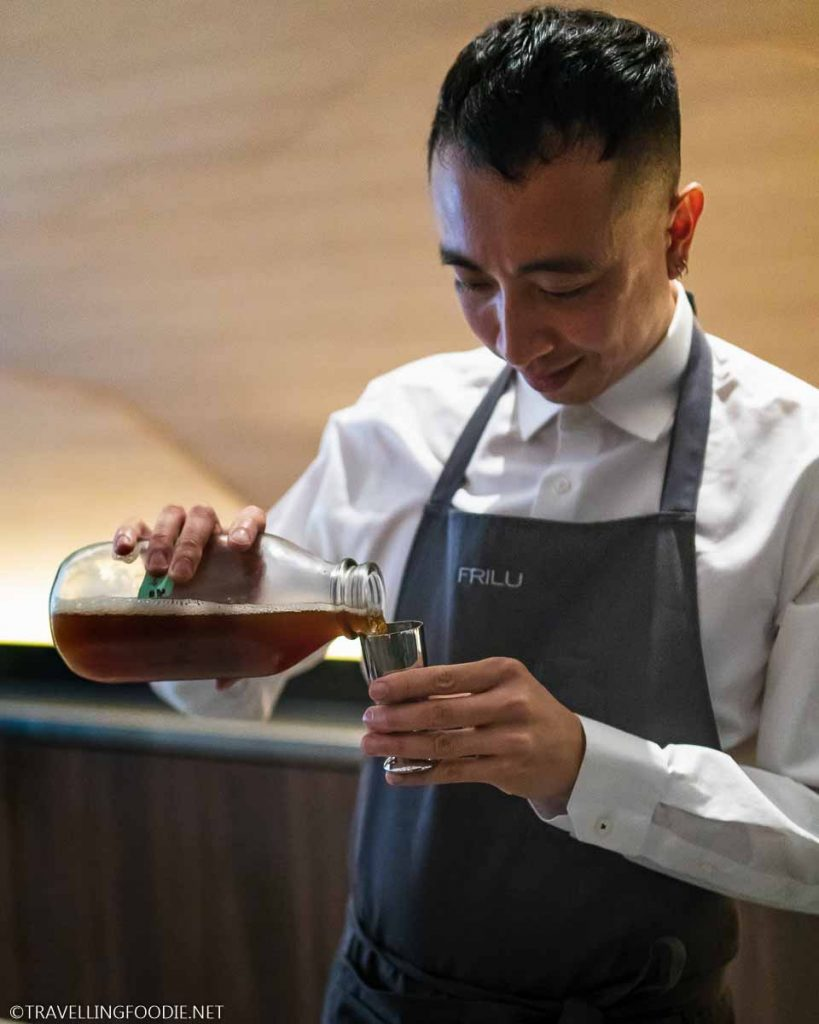 Bartender pouring Cold Brew Tea on a jigger
