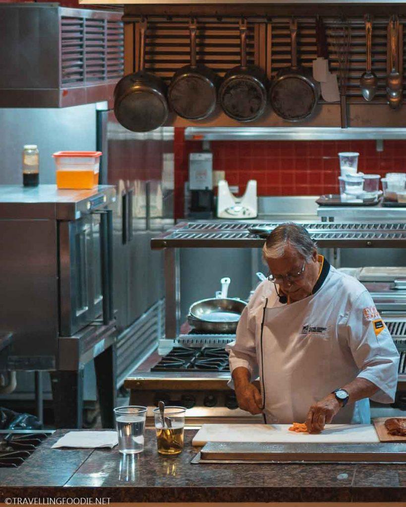 Chef Roland Menetrey slicing carrots in the Master Class kitchen for Puerto Vallarta Festival Gourmet International