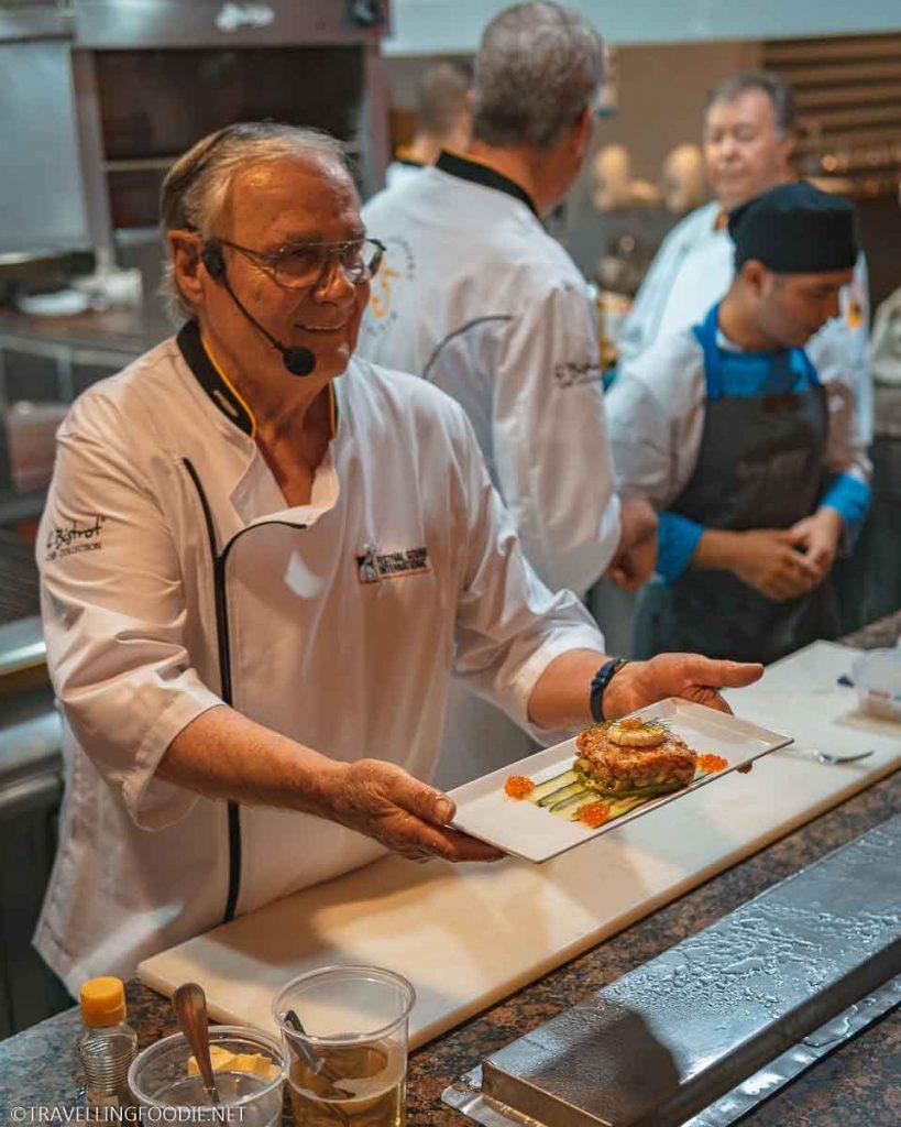 Chef Roland Menetrey presenting the Smoke Salmon Tartare at Cafe des Artistes in Puerto Vallarta, Mexico
