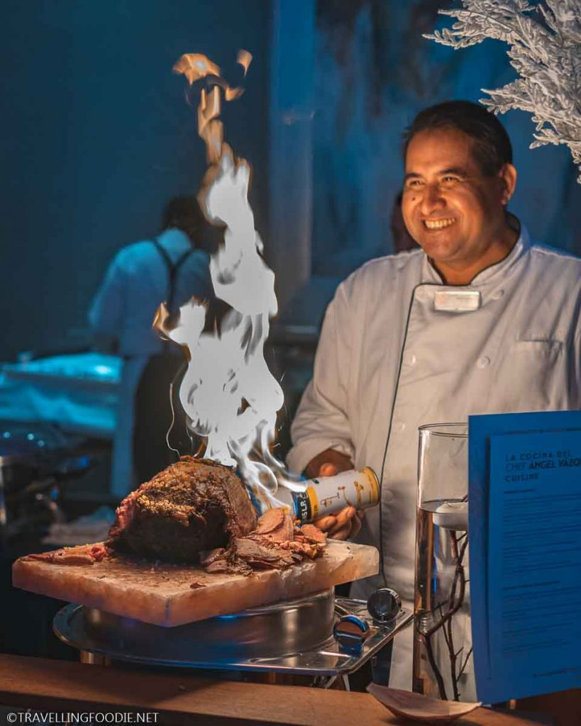 Chef Angel Vazquez torching the ribeye for Festival Gourmet International Grand Gourmet Village
