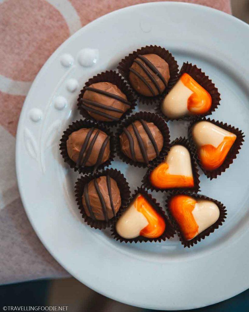 Milk Chocolate Truffle Ball and Heart-Shaped White Chocolate Passion Fruit from Xocodiva Artisan Chocolate in Puerto Vallarta, Mexico