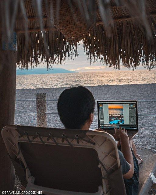Travelling Foodie Raymond Cua editing sunset photo on Adobe Lightroom in Microsoft Surface Laptop 3