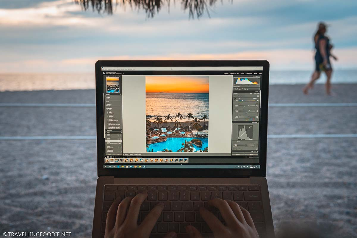 Editing photo on Microsoft Surface Laptop 3 on Playa Camarones Beach in Puerto Vallarta, Mexico