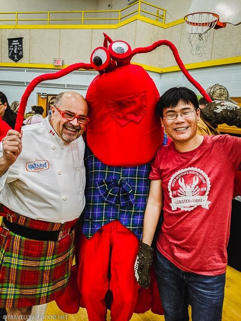 Chef Alain Bosse and Travelling Foodie Raymond Cua with Lobster Mascot at Lobster Chowder Chowdown Showdown in Chester, Nova Scotia