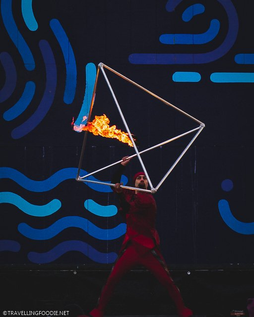 Fire Dancer holding metal pyramid at Montreal Festival of Lights