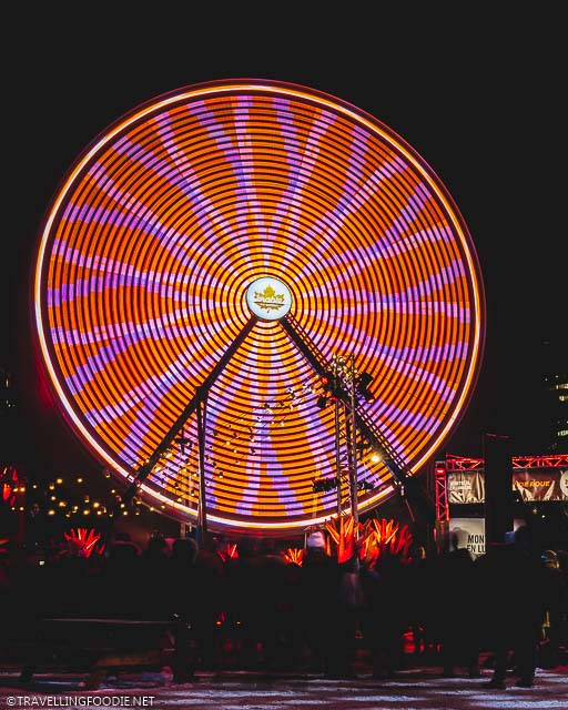 Quebec Maple Ferris Wheel at Night when moving during Montreal Festival of Lights