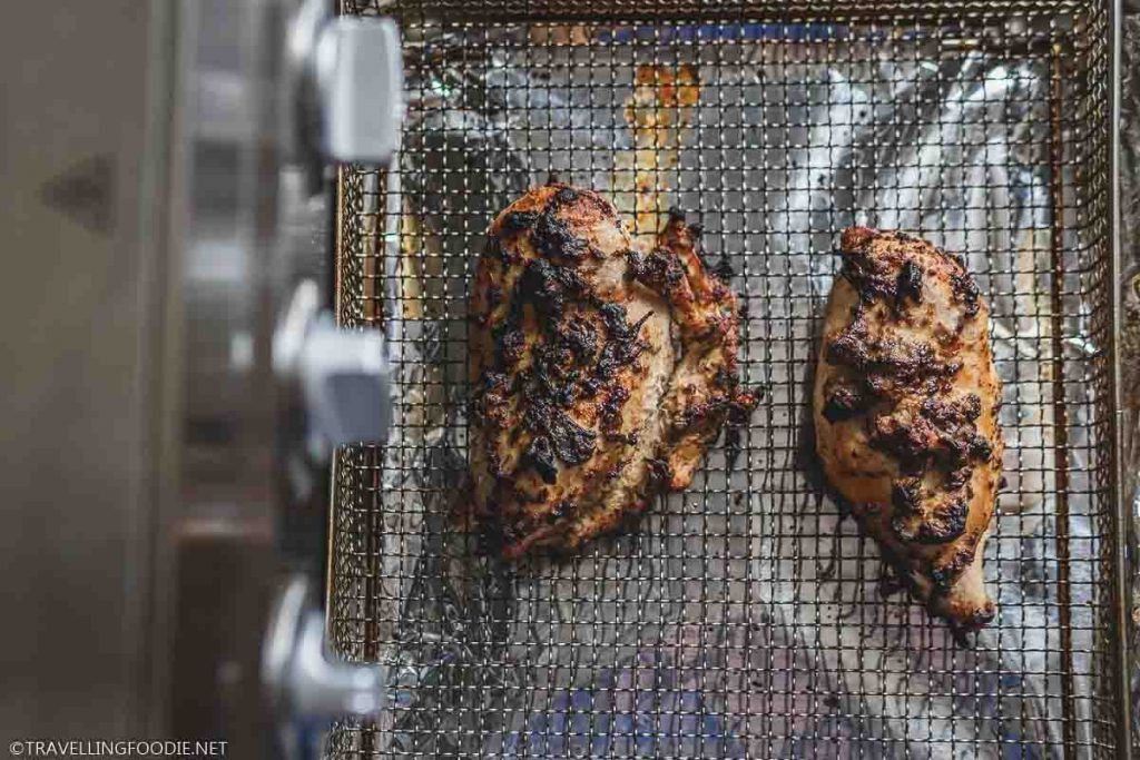 Two Pieces Chicken Breasts on Air Fryer Basket