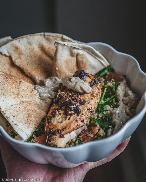 A Bowl of Air Fried Chicken, Warm Pita, Baba Ghanoush and Tabbouleh