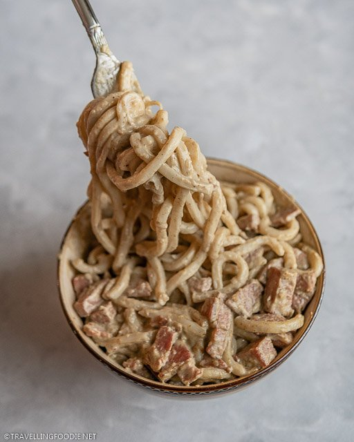 Thai Curry Udon Noodle Lifting with Fork