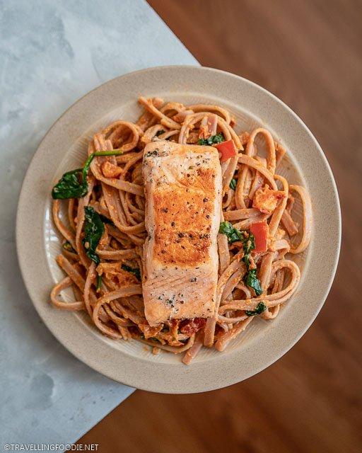 Salmon tagliatelle with homemade creamy sun dried tomato pesto pasta sauce