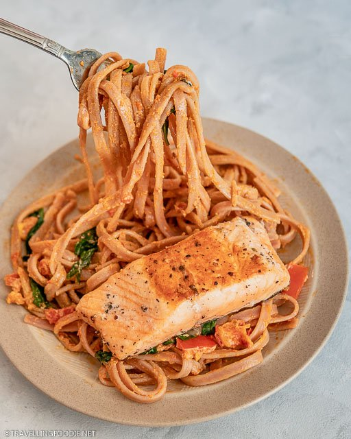Creamy tomato pasta with salmon and homemade Italian pasta sauce with cream