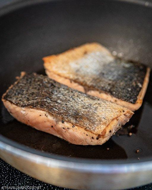 Pan-seared salmon fish skin on pan