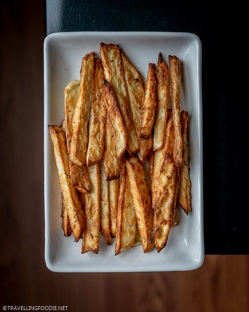 Fries with toppings of salt and thyme